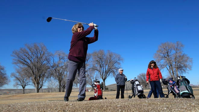 Lin Fagundes tees off Tuesday during a round of golf with her friends Kay Ammerman and LaVeta Cockrell at Riverview Golf Course in Kirtland.