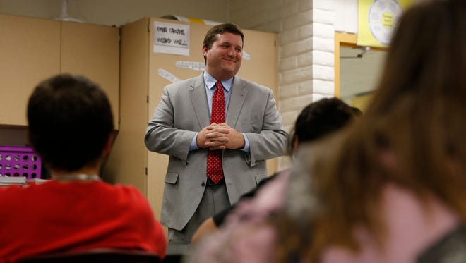 Chris Minnich, executive director of the Council of Chief State School Officers,  talks to seventh-grade students from Robin Bellah's class on Thursday at Heights Middle School in Farmington.