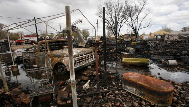 The charred remains of a structure fire are pictured Saturday in Kirtland.