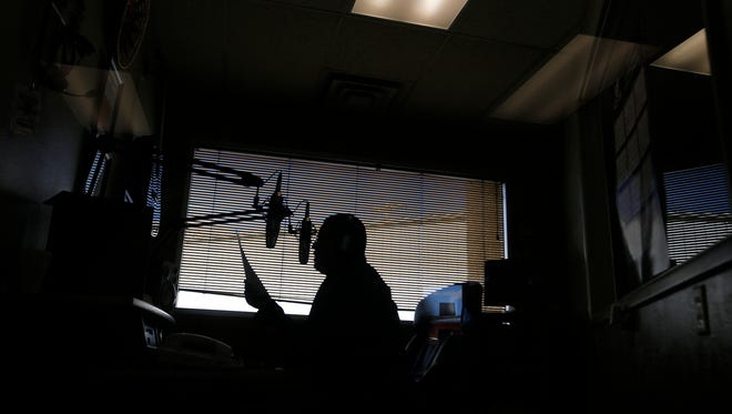 Lydell Rafael, producer and director for KNDN's AM and FM stations, speaks live on the air Monday at the FM station in Farmington.