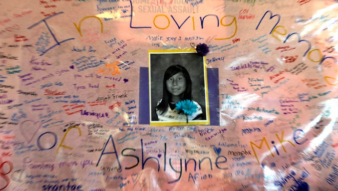 Messages from the community are written on a poster for Ashlynne Mike on display inside the lobby of the Farmington Civic Center on May 6.