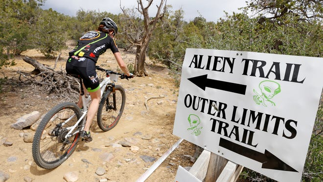 A rider continues on the trail during the Alien Run Mountain Bike competition May 3, 2015, at Hart Canyon in Aztec.
