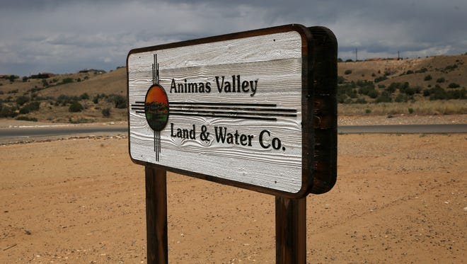 A  sign for the Animas Valley Land and Water Co. building is pictured on June 13 in Crouch Mesa.