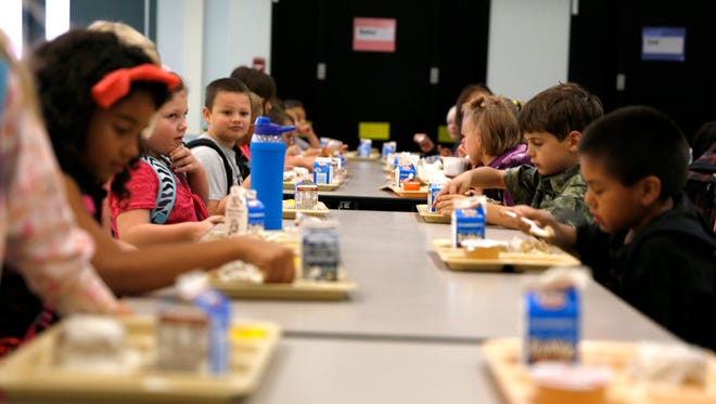 Students eat breakfast in the cafeteria Sept. 3 at Lydia Rippey Elementary School in Aztec. An after-school program that serves students at the school and several other in the county has lost its funding, jeopardizing its future.