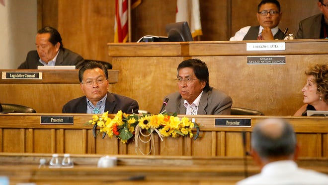 Navajo Nation Gaming Enterprise CEO Derrick Watchman, left, and Delegate Leonard Tsosie present a bill to fund a travel center at the Twin Arrows Navajo Casino Resort on Wednesday during a session of the Navajo Nation Council in Window Rock, Ariz.