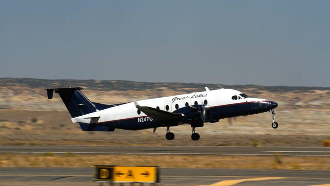 A Great Lakes Airlines passenger plane headed to Denver takes off on Monday from the Four Corners Regional Airport in Farmington.