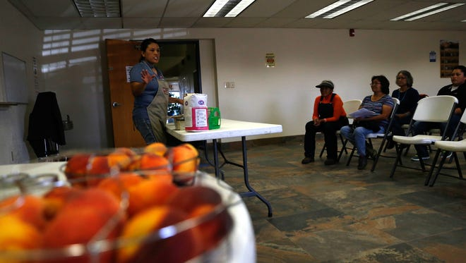 Leah Platero leads a canning workshop, Friday, Sept. 23, 2016 during the Nenahnezad Harvest Festival at the Nenahnezad Chapter House in Fruitland.