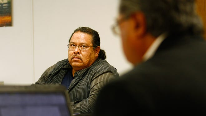 Navajo Nation Office of Hearings and Appeals Hearing Officer Joe Aguirre, right, presides over a hearing for Frank Smith, left, Tuesday at the Navajo Nation Department of Workforce Development office in Shiprock.