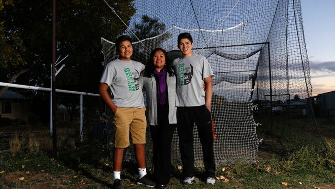 Shawna Becenti poses for a portrait with her sons Kowyn Becenti, left, and Kody Becenti on Wednesday at their home in La Plata.
