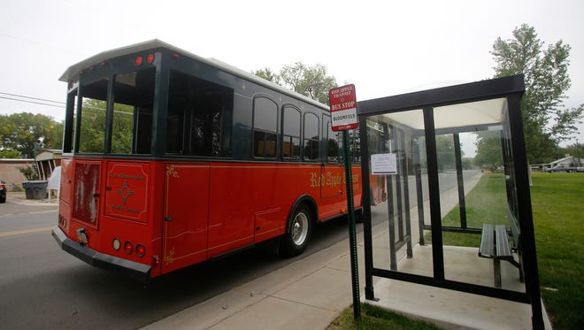 A Red Apple Transit bus makes a stop on Sept. 20 on South First Street in Bloomfield. The City Council will consider a new contract with Red Apple Transit at its Monday meeting.