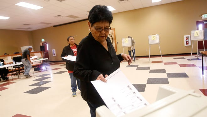 Vicki Bedoni casts her ballot on Tuesday at the Upper Fruitland Chapter house.