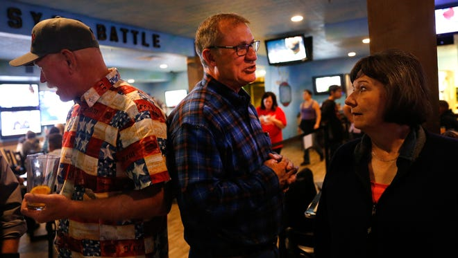 At center, state Rep. James Strickler, R-Farmington, talks with fellow watch party attendees on Tuesday at No Worries Sports Bar and Grill in Farmington.