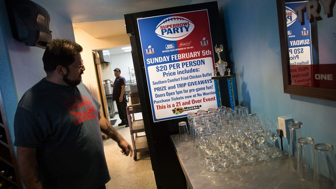Tony Lake, general manger of No Worries Sports Bar and Grill, talks Friday about the business' Super Bowl party planned for Sunday.