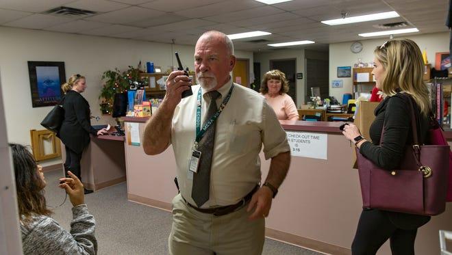 Mesa View Middle School Vice Principal David Gardner communicates with his staff Thursday at his school in Farmington.