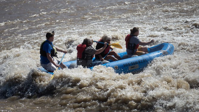 From left, San Juan student Sean Henkenius, River Reach Foundation board member Rick Page, San Juan College facility manager Jill Ward and San Juan College student Jeffery Downing ride the rapids Wednesday at the Penny Lane Dam in Farmington.