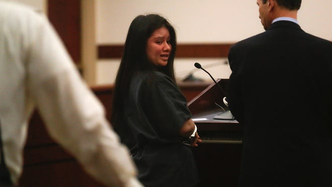 Charmaine Lucero apologizes to her shooting victim, Cameron Burton, Thursday during her sentencing in Aztec district court.