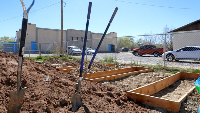 Garden beds await set up March 28, 2015, during a workshop at the Dream Dine Charter School in Shiprock.  The Farmington Public Library will present a number of events related to community gardening this spring during its On Common Ground series.