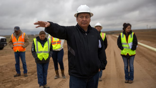 NAPI Chief Executive Officer Wilton Charley talks about starting an organic farming operation Tuesday at Navajo Agricultural Products Industry headquarters south of Farmington.