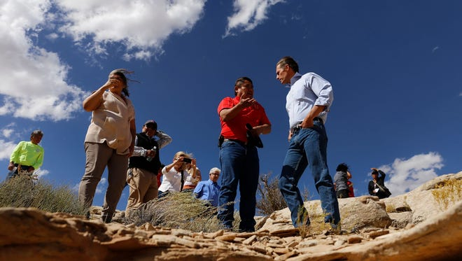 In this file photo, U.S. Sen. Martin Heinrich, D-N.M., right, talks on Oct. 2, 2015, with Gilbert Dayzie, a civil engineer with the Shiprock Abandoned Mine Land Reclamation Program, while touring a former uranium mine in the Red Valley Chapter in Arizona.