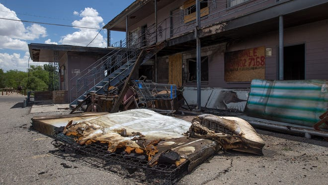 Charred items from the closed Sage North Motel in Farmington sit in the parking lot on Friday after an early-morning fire damaged the building.