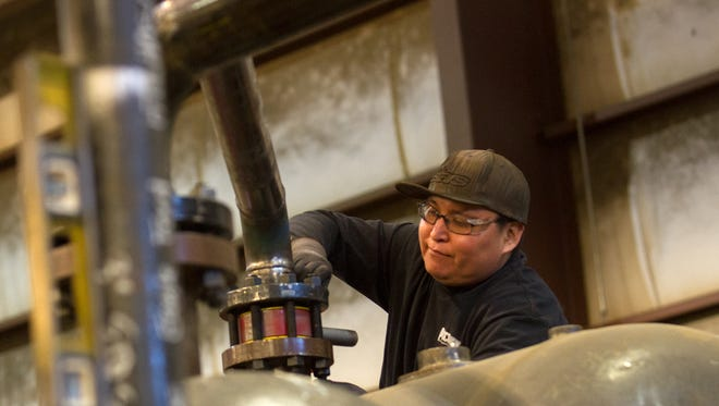 Orlando Begaye, an assistant welder for PESCO, works on a unit Jan. 6 at the company's headquarters.