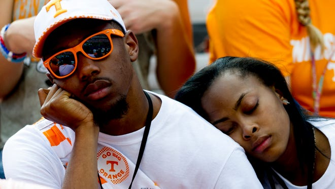 UT fans take a nap during the Tennessee Volunteers vs. UMass Minutemen game at Neyland Stadium in Knoxville, Tennessee on Saturday, September 23, 2017.