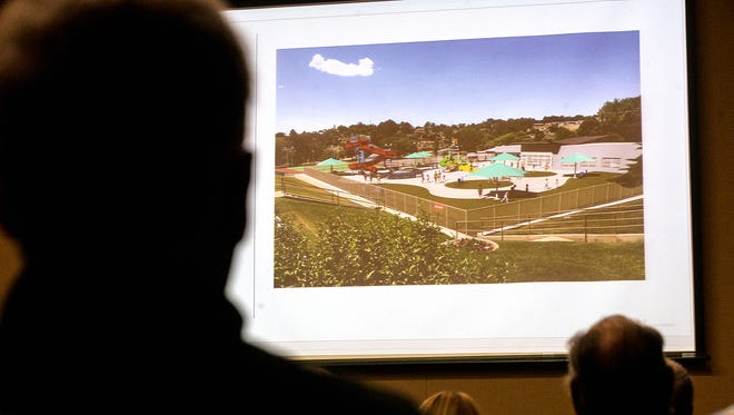 Representatives of FBT Architects give a presentation on the designs for a planned aquatic center at Brookside Park during a community meeting Feb. 20, 2017, at the Farmington Civic Center.