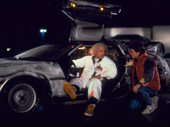 "Doc Brown (Christopher Lloyd) shows Marty McFly (Michael J. Fox) his time machine in ""Back to the Future."" (Yes, he built a time machine out of a DeLorean.)"