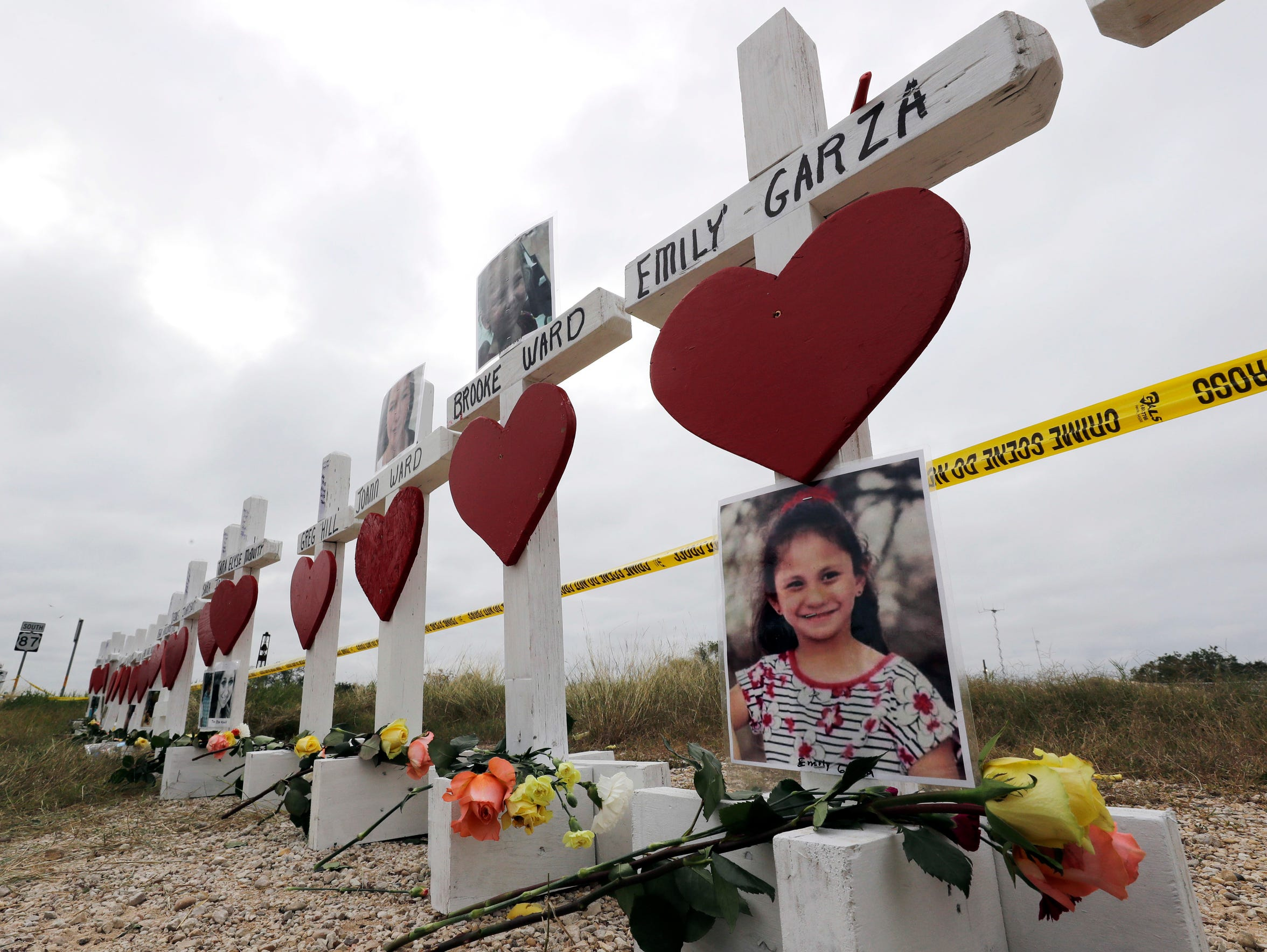 Crosses showing shooting victims stand near the First Baptist Church on Nov. 9, 2017, in Sutherland Springs, Texas.  Emily Garcia's name was incorrectly spelled in the memorial display. The 7-year-old died of gunshot injuries at University Hospital in San Antonio.