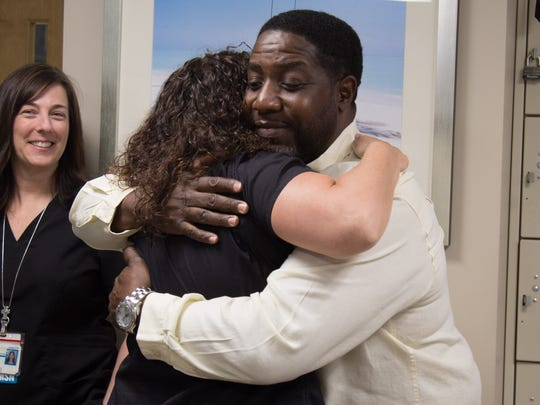 Robert Stewart and his wife, Donyale, visit the Emergency Department, Medical Intensive Care Unit and with security staff on Monday at Martin Medical Center in Stuart.
