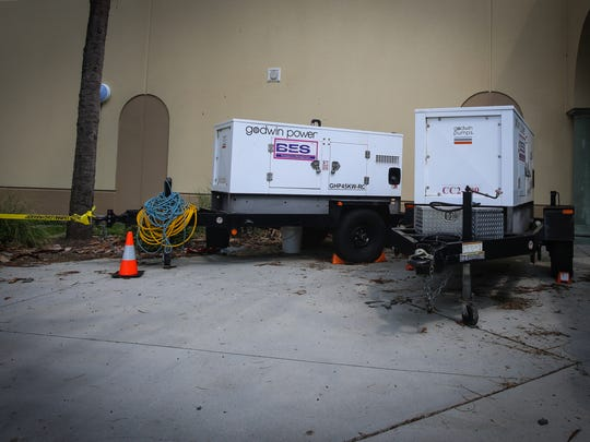 Two generators sit outside Palmetto Ridge High School Thursday, Sept. 21, 2017. Palmetto Ridge was used as a special needs shelter during Hurricane Irma and one of these generators was used to power oxygen.