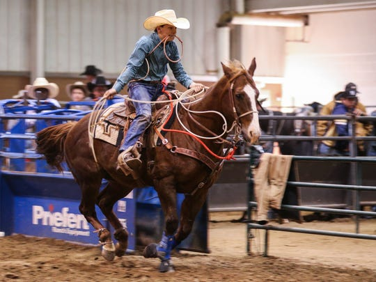Hadley White rides out to rope during the 64th annual