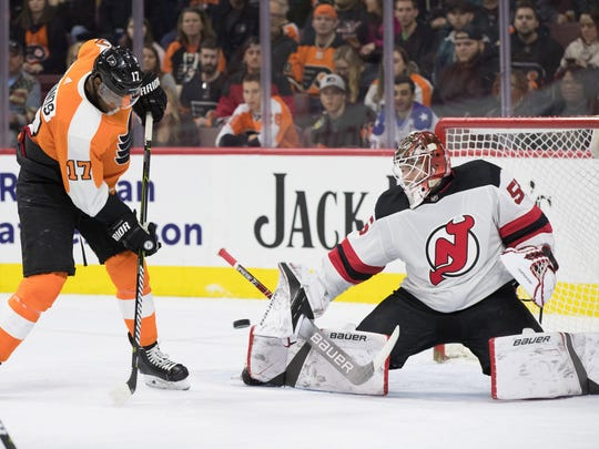 New Jersey Devils goaltender Ken Appleby (55) makes a save on a tip attempt by Philadelphia Flyers right wing Wayne Simmonds (17) during the second period at Wells Fargo Center.