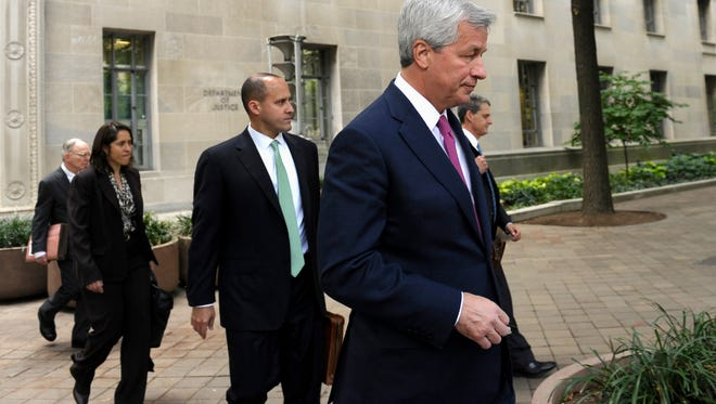 JPMorgan Chase CEO Jamie Dimon leaves the Justice Department in Washington on Thursday.