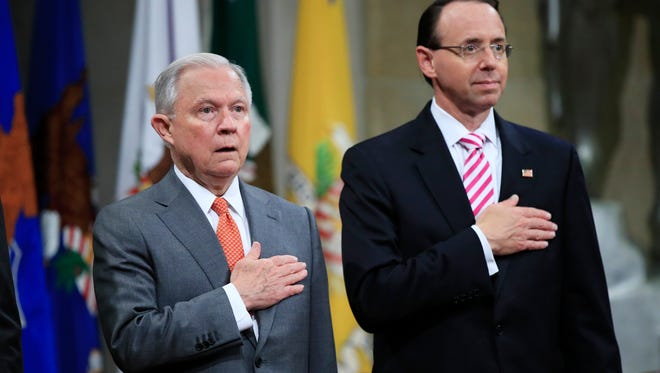 Attorney General Jeff Sessions, left, and Deputy Attorney General Rod Rosenstein sing the National Anthem during a Religious Liberty Summit at the Department of Justice on July 30, 2018.
