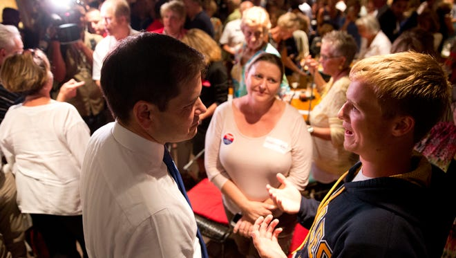 Junior United States Senator Marco Rubio, left, speaks with Naples resident Jonathan Poteet, 17, and his mother Cheryl after Rubio spoke at a campaign event at 7th Avenue Social to encourage Republican citizens of Collier and Lee County to vote as early as possible Thursday, October 27, 2016 in Naples.