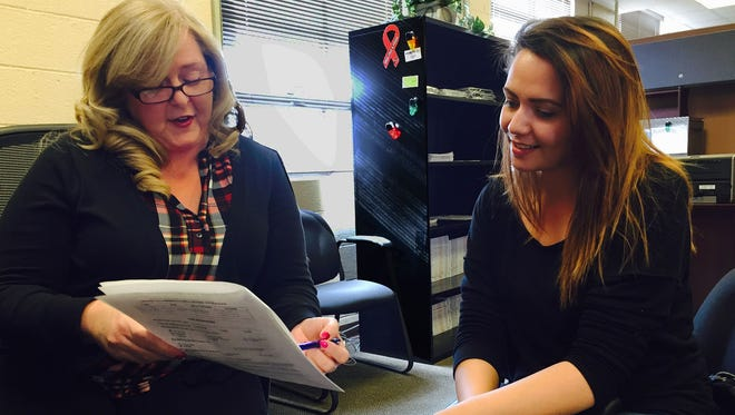 Denise Carothers, left, an employment readiness educator, works with Gabriella Herrera, an Army dependent, on her resume. Fort Bliss Employment Readiness will have a job fair Feb. 25.