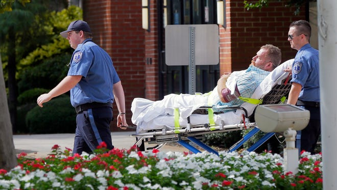 Michael Lombardo, who is responsible for the death of a USMC veteran after a St. Patrick's Day bar fight, is taken to the hospital after becoming lightheaded during his sentencing before Judge Wendel E. Daniels at the Ocean County Courthouse in Toms River, NJ Friday September 9, 2016.
