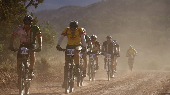Riders cruise during a plateau in the 3rd Annual Fire Road Cycling Race on July 5, 2014. Cedar City officials announced the 2016 race has been cancelled.