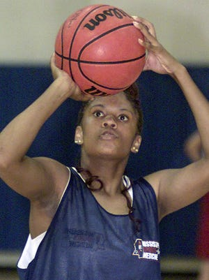This 2002 photo shows Ebony Jenkins of Crystal Springs shooting free throws during practice for the Mississippi Girls All-Star game.