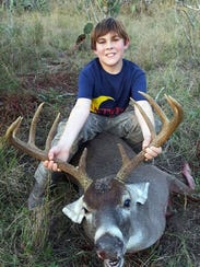 J. Curtis Cantwell, 11, killed this 10-point buck while