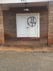 A pentagram was spray painted on the door of Joy Fellowship