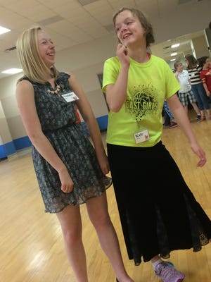 Mentor Natalie Ollhoff, 16, (left) works with Kate Sutherland, 11, who will portray Annie in an upcoming Central Wisconsin Children's Theatre production of the musical.