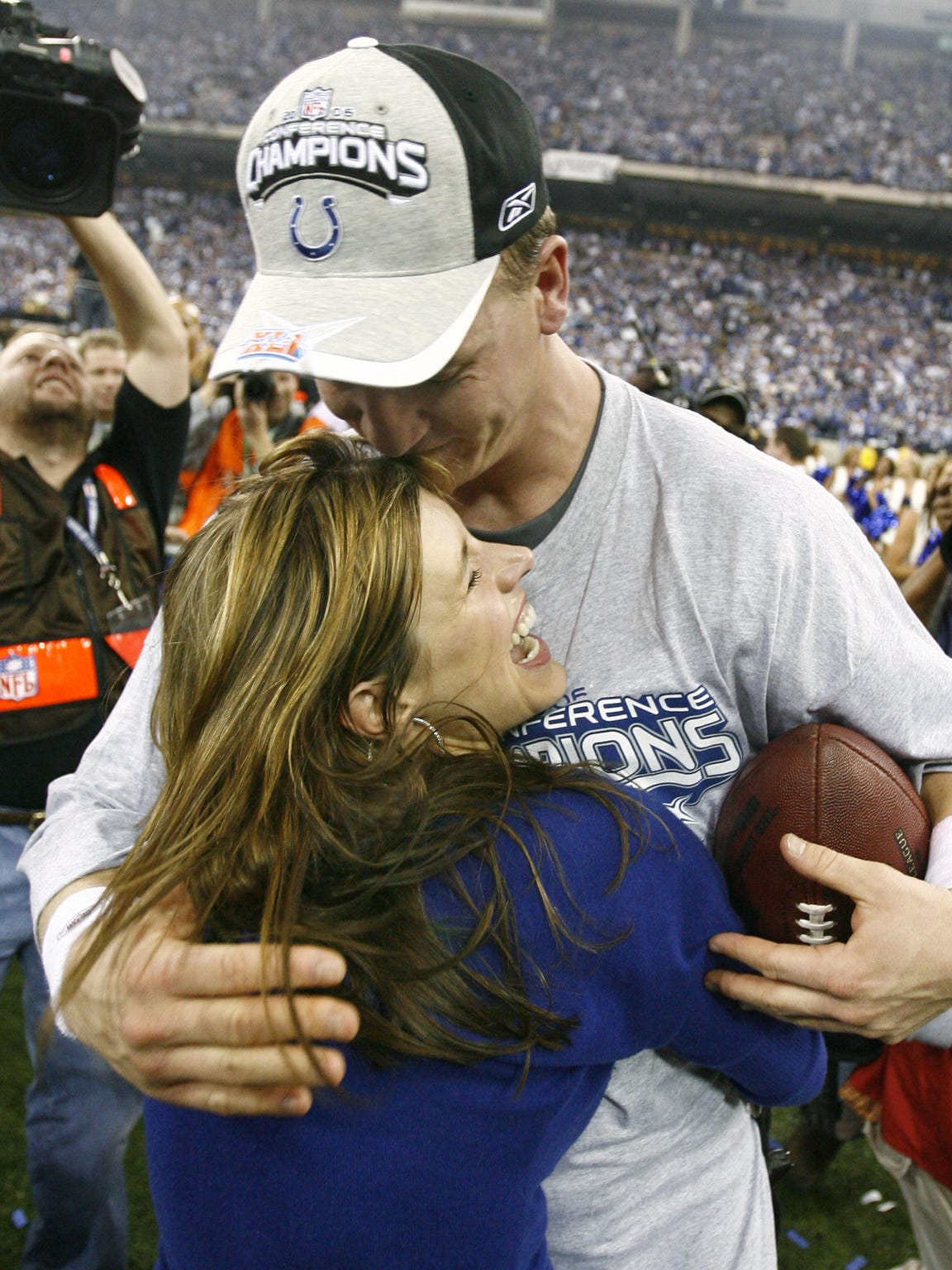 Peyton Manning gets a hug from wife Ashley after the