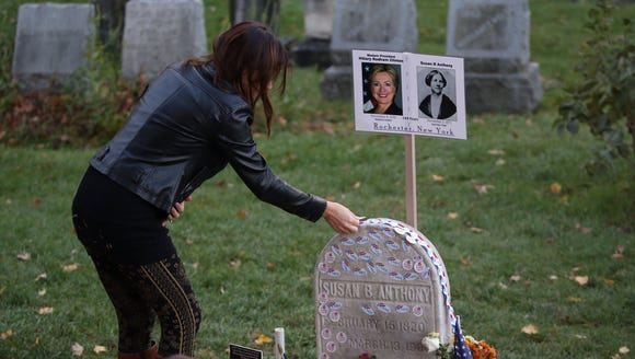 "Jillian Paris places an ""I Voted"" sticker on the headstone"