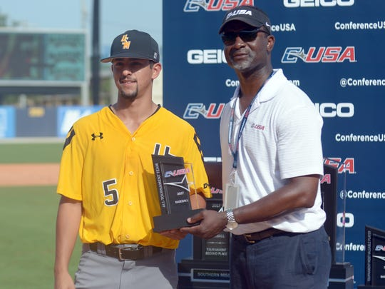 Southern Miss player Nick Sandlin is given an award during the Conference USA Championship game against Rice at MGM Park in Biloxi on Sunday.