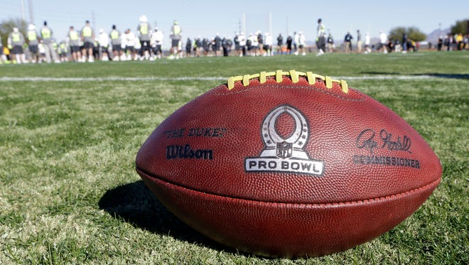 A football sits on the field during practice for the NFL Football Pro Bowl Saturday, Jan. 24, 2015, in Scottsdale, Ariz. The game is scheduled to be played Sunday in Phoenix. (AP Photo/Mark Humphrey)