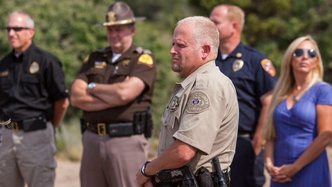 """Iron County Sheriff Mark Gower attends the Southwest Wildlife Foundation's eagle release event dedicated to first responders at the """"C"""" overlook in Cedar City, Friday, August 19, 2016."""