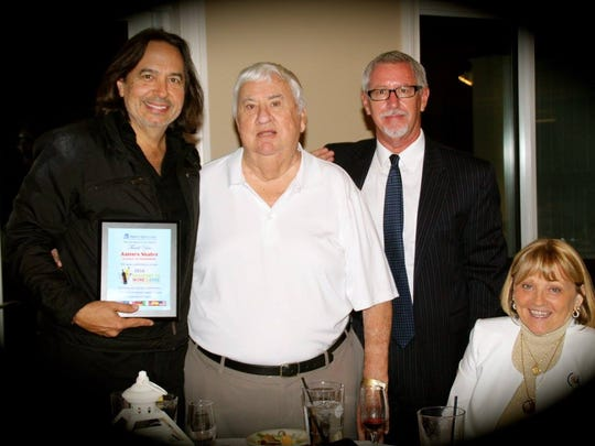 Musical guest James Slater was presented a thank you plaque by former Board Chair and friend Robert Lowe Sr. and his wife Sharon, along with Hibiscus Children's Center CEO Paul Sexton.
