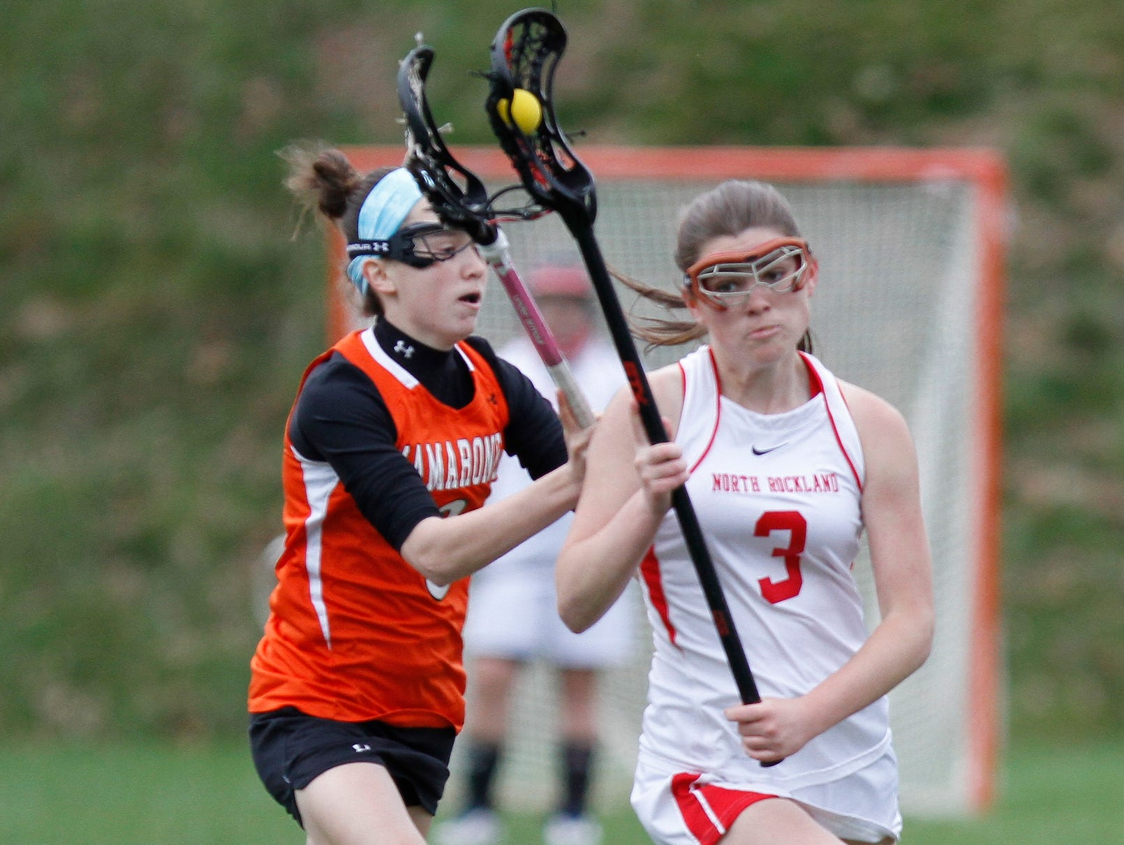North Rockland's Jenna Fox (3) stick-handles the ball around Mamaroneck's Madeline Rioedan (3) during a girls lacrosse game at North Rockland High School in Thiells on Saturday, April 02, 2016.